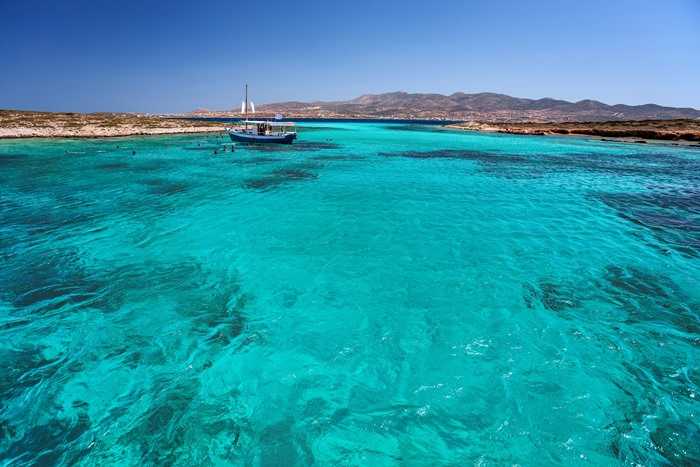 Blue lagoon between Paros and Antiparos islands, Cyclades, Greece