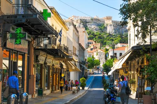 Athens city with walking people
