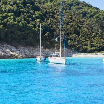 Sailboat yachts in Mediterranean bay. Greece