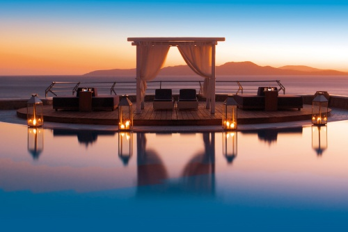 Grand Hotel Mykonos pool at sunset