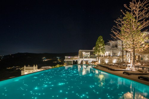 Myconian Utopia pool at night