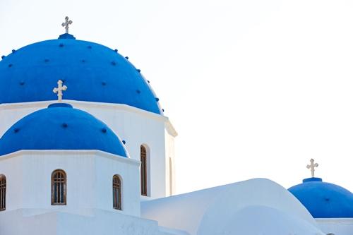 Classic view of blue dome church in Santorini.
