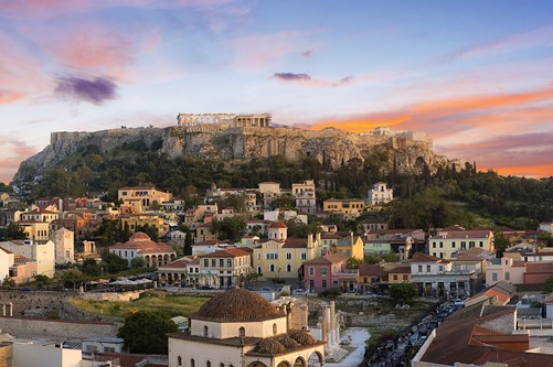 Acropolis of Athens at sunset and the old city in the foreground